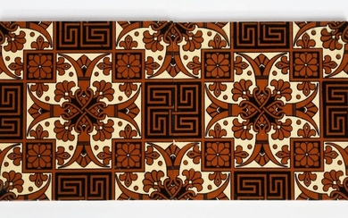 A pair of large Mintons China Works tiles designed by Dr Christopher Dresser, each printed in brown and black with a geometric flower, fleur de lys and Greek key repeat design, impressed marks, 20.5cm. square (2)