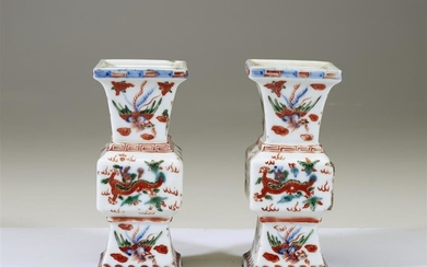 A pair of small Chinese wucai-decorated porcelain vases apocryphal...