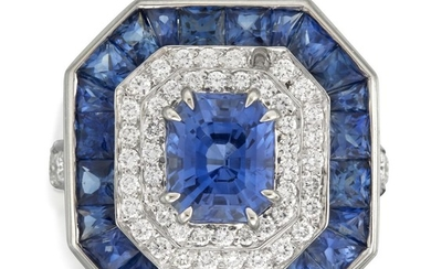 A sapphire, diamond, and platinum ring centering a radiant-cut...