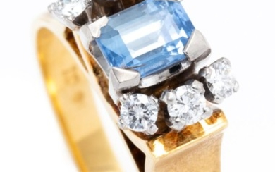 AN 18CT GOLD SAPPHIRE AND DIAMOND RING; centring an emerald cut blue Ceylon sapphire of approx. 0.60ct to upswept shoulders set with...