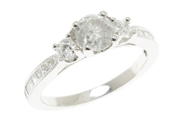 AN 18CT WHITE GOLD DIAMOND RING; centring a round brilliant cut diamond estimated as 0.54ct, P2 to shoulders set with 2 round brilli...