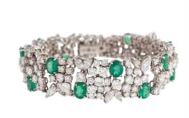 AN EMERALD AND DIAMOND FANCY BRACELET with diamonds of appro...