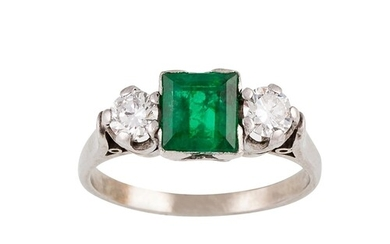 AN EMERALD AND DIAMOND THREE STONE RING, the square cut emer...