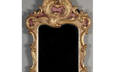 AN ITALIAN GILTWOOD WALL MIRROR in 18th century style, carve...