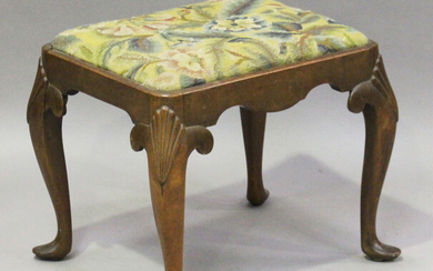 An early 20th century Queen Anne style walnut stool, the drop-in woolwork seat on scallop shell carv