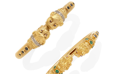 An etruscan style hinged bangle together with a lion head bangle