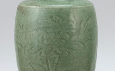 """CHINESE CARVED CELADON STONEWARE VASE In baluster form, with foliate designs. Height 10.25""""."""