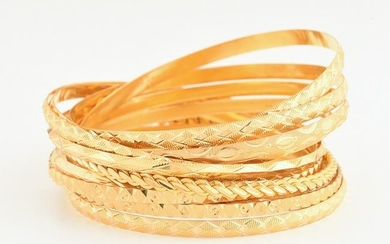 Collection of Twelve 22k Yellow Gold Bangle Bracelets.