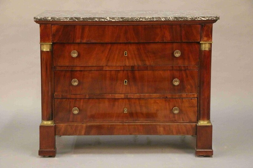 Mahogany veneer COMMODE opening by four drawers. Upright with half columns and bronze rings. Marble top. Empire style, end of the 19th century. (Some restorations, two locks without keys) H : 91 cm W : 113,5 cm D : 57 cm