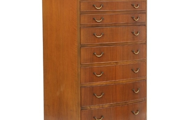 Ole Wanscher: Chest of drawers of nutwood. Curved front with eight profiled drawers with brass handles.