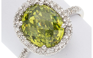 Peridot, Diamond, White Gold Ring The ring features an...