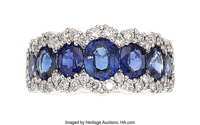 Sapphire, Diamond, White Gold Ring The ring features oval-shaped...