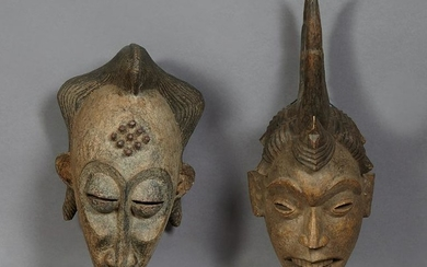 Two African Carved Wood Masks, 20th c., one of a woman