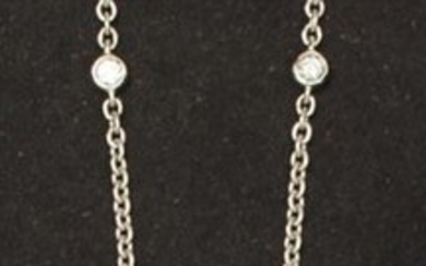 White gold necklace, set with a brilliant-cut diamond...