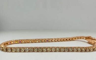 14ct Rose Gold Diamond tennis bracelet featuring, 59...