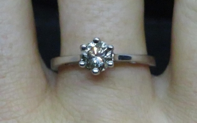 18ct white gold and diamond solitaire ring approx .6ct fully...