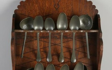 19th Century oak spoon rack with pewter spoons.&#160