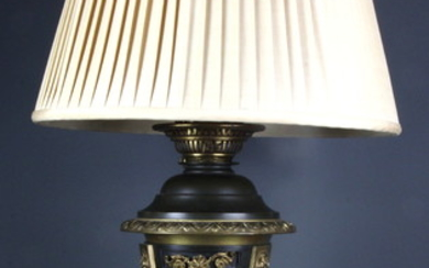 A 19th Century French gilt bronze and marble oil lamp converted into a table lamp, H. 67cm.