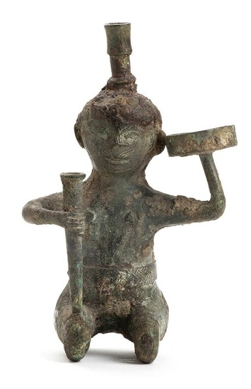 A BRONZE ANTROPOMORPHIC OIL LAMP China, Han dynasty The...