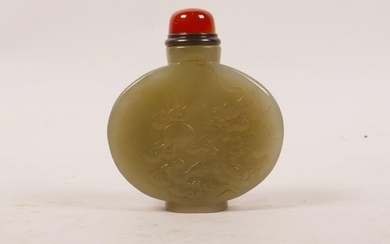 A Chinese celadon jade snuff bottle with carved decoration o...