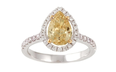 A DIAMOND CLUSTER RING, the fancy yellow pear shaped diamond...