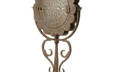 A GILT DECORATED METAL MIRROR HOLDER