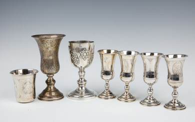 A GROUP OF SEVEN STERLING SILVER KIDDUSH CUPS. American,...