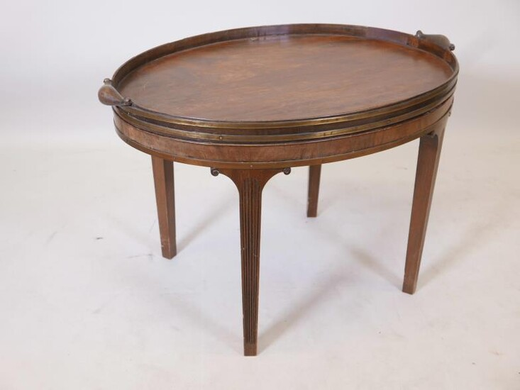 A Georgian brass bound mahogany oval gallery tray with...