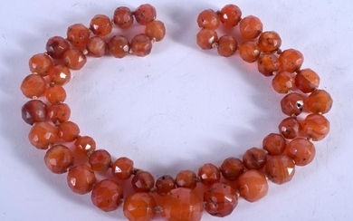 A MIDDLE EASTERN CARNELIAN AGATE NECKLACE. 60 cm long.