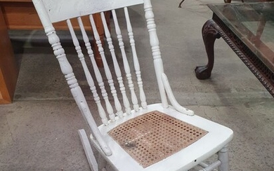 A PAINTED COLONIAL ROCKING CHAIR
