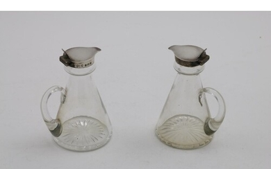 A PAIR OF EARLY 20TH CENTURY MOUNTED GLASS WHISKY TOTS with ...