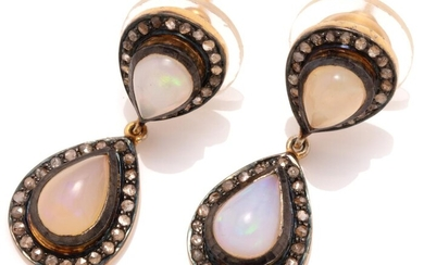A PAIR OF OPAL AND DIAMOND EARRINGS; double pear shape clusters each centring a cabochon crystal opal surrounded by rose cut diamond...