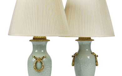 A PAIR OF ORMOLU-MOUNTED CELADON PORCELAIN VASE TABLE LAMPS, MID-20TH CENTURY, THE CELADON PORCELAIN POSSIBLY EARLIER