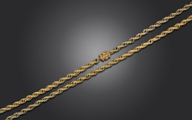 A Regency long guard chain, the twisted circular links with granular decoration in yellow gold, the barrel-shaped claps set with seed pearls, 79cm long, 32g