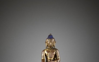 A SMALL GILT COPPER ALLOY FIGURE OF SHAKYAMUNI...