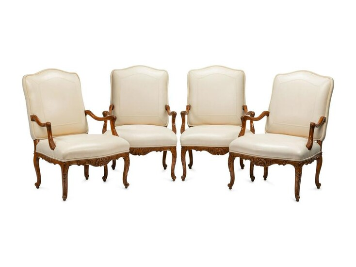 A Set of Four Regence Style Leather-Upholstered
