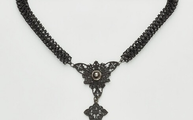 A cast iron necklace with a cross pendant