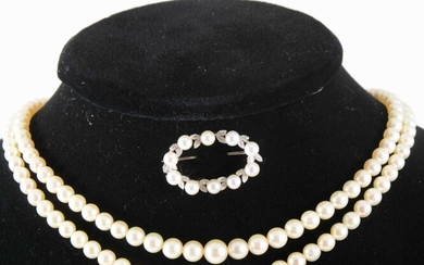 A cultured pearl two row necklace and pearl set brooch.