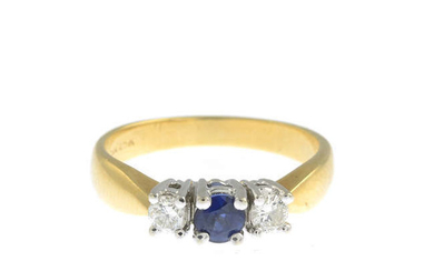 A gold diamond and sapphire ring.