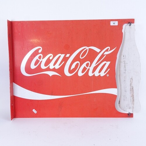 A large Vintage red and white Coca-Cola advertising sign, wi...