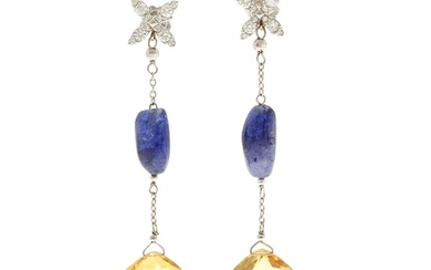 A pair of citrine, sapphire and diamond ear pendants each set with a citrine, a sapphire and numerous diamonds, mounted in 18k white gold. L. app. 6.9 cm. (2)