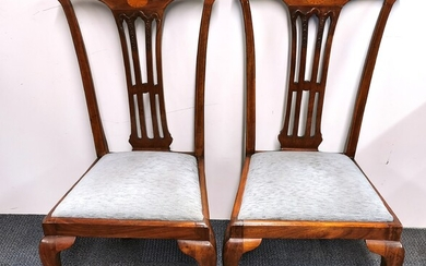 A pair of inlaid mahogany Chippendale style dining chairs.