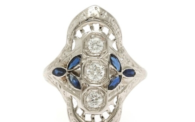 A sapphire and diamond ring set with six marquise-cut sapphires and three brilliant-cut diamonds, mounted in 18k white gold. Size 49.