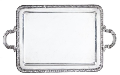 A silver-plated tray decorated with leafs