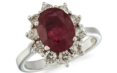 AN 18CT WHITE GOLD RUBY AND DIAMOND CLUSTER RING, an