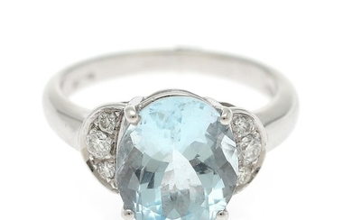 An aquamarine and diamond ring set with an oval-cut aquamarine flanked by six brilliant-cut diamonds, mounted in 18k white gold. Size 51.5.