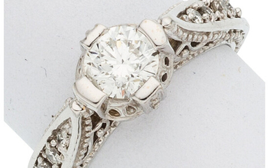 Diamond, White Gold Ring The ring features a round...