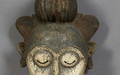 Large African Carved Wood Female Mask, 20th c., with