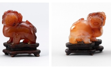 "PAIR OF CHINESE CARVED CARNELIAN FIGURES OF FU DOGS Heights 2"". With wood stands."