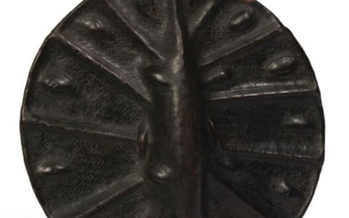 Rare leather shield decorated with embossed patterns. Deep...